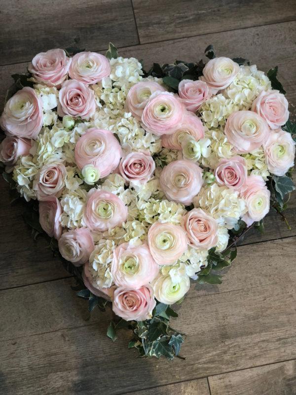 Coeur rose pâle et blanc